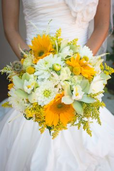Sunflower, orchid, yellow balls and mums bridal bouquet // Photographer: Hazy Lane Studios // Sunshine Flowers Wedding & Event Design // http://www.theknot.com/submit-your-wedding/photo/1db95ce6-8040-4df6-a519-24fc338f702a/Rogers-Wedding