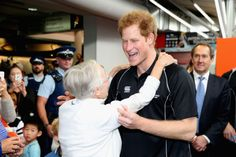 Prince Harry is given a farewell hug as he leaves the AUT Millennium Institute of Sport and Health, in Auckland