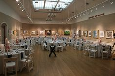 There is plenty of room inside an art gallery for dinner and dancing at your wedding reception at Mystic Arts Center.