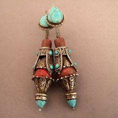 """A pair of antique earrings (late century) from Lhasa in Tibet . great job on silver turquoises, this type of coral is called""""bamboo coral"""" ~ETS Ethnic Jewelry, Tibetan Jewelry, Turquoise Jewelry, Silver Jewelry, Coral Turquoise, Antique Earrings, Antique Jewelry, Vintage Jewelry, Handmade Jewelry"""
