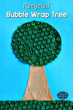 Making crafts out of recycled materials like this Recycled Bubble Wrap Tree is a fun way to teach children about Earth Day and reusing, reducing, and recycling. #recycledcraftsforchildren