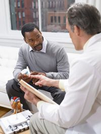 A patient discusses medication with his doctor.