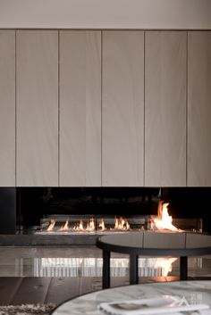 Like the cabinetry above this fireplace by DA Interior Taiwan Home Fireplace, Modern Fireplace, Living Room With Fireplace, Fireplace Design, Fireplaces, Home Living Room, Interior Design Living Room, Living Tv, Modern Mansion