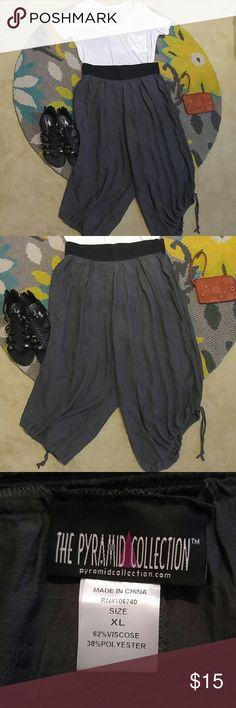 NWOT Pyramid Collection gypsy capris This is a gorgeous NWOT pair of super light black gypsy capris. They have drawstrings on the legs to make them gathered on the sides. Never been worn! The Pyramid Collection Pants