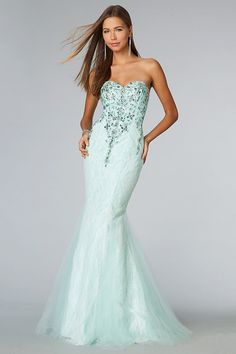 """Start out searching for your perfect long maxi strapless light turquoise prom dress by flipping through magazines and online to see what kind of dress you are most attracted to. Then hit the stores with an idea in mind of what you are looking for. Try on as many dresses as you can; your idea of the """"perfect dress"""" may not be as well suited for you as another style. Don't limit yourself."""
