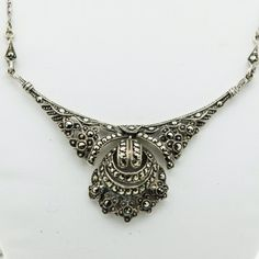 A vintage Silver and Marcasite delicate open work necklace, to the centre is a suspended section set with with Marcasite that moves and catches the light, total length 41cms or 16 inches
