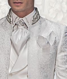 White shirt with silver floral embroidered and white ascot with handkerchief.