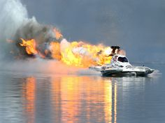 """Top fuel hydro driver Todd Plate explodes the engine on fire to his boat """"Problem Child"""" during the Lucas Oil Drag Boat Racing Series World Finals in Chandler, Ariz.  Mark J. Rebilas, USA TODAY Sports"""
