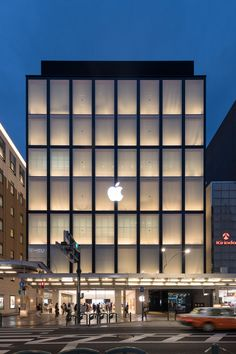 Foster + Partners has completed the first Apple Store in Kyoto, which is fronted by a translucent facade made from a lightweight timber frame and paper - architecture Architecture Design, Retail Architecture, Minimalist Architecture, Facade Design, Facade Architecture, Retail Facade, Shop Facade, Building Facade, Building Design