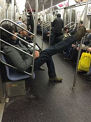Rude Dude Lounging Like He Owns the Subway Train