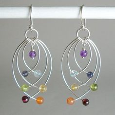 Chakra Balancing Earrings Wear these delicate Chakra Balancing Earrings to balance all chakras in a fun way! These beautiful sterling silver earrings with genuine Chakra Gemstones are 2 inches long.