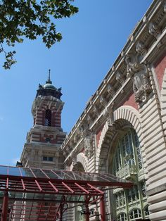 Ellis Island National Monument, New York Harbor, New York - Plans were immediately made to build a new, fireproof immigration station on Ellis Island. During the construction period, passenger arrivals were again processed at the Barge Office. The present main structure was designed in French Renaissance Revival style and built of red brick with limestone trim. When it opened on December 17, 1900, officials estimated 5,000 immigrants per day would be processed.