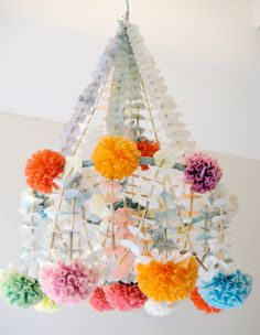 We have white chandeliers that have places for guests to easily attach pops of color!