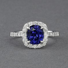 Royal Blue Sapphire & Diamond Halo Ring in 18K White Gold