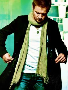 Jeremy Renner I love him in this outfit with that green scarf. So hot!!!