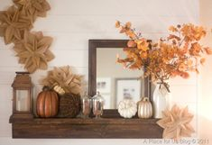 Use humble materials to make a big statement.  These big brown paper flowers are inexpensive to make, but they add so much to this fall mantel!  Whimsy, texture, and warm earth tones make this mantel one of my all-time favorites.