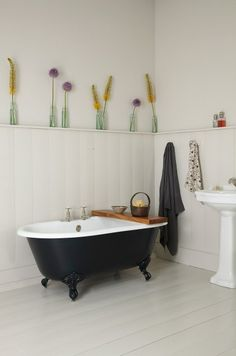The Petite Millbrook Cast Iron Bath is super cute for a small bathroom Painted in Farrow & Ball's 'Off Black'. 'Skimming Stone' walls and floor