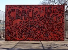 """In 1986, Keith Haring got a $25 ticket for painting graffiti on a handball court in East Harlem. Perhaps sensing the crack epidemic of the 1980s reaching a fever pitch, the Parks Department contacted him months later with a request to finish the mural. The two murals on either side of the wall not only still stand, the Parks Department has officially named the park the """"Crack is Wack Playground,"""" acknowledging it among the most salient dedications of public art in the city."""