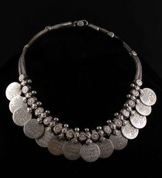 India | Vintage silver wedding necklace | Good silver. The hanging coins have arabic writing and have a diameter of 1,8 cm (0,65″) | Sold