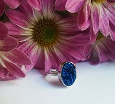 This beautiful genuine blue drusy quartz oval ring will go with just about any outfit in your closest!
