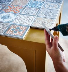 - Furniture and Home Furnishings The top of a gold IKEA LACK table is being decorated with decorative tiles.The top of a gold IKEA LACK table is being decorated with decorative tiles. Easy Home Decor, Handmade Home Decor, Cheap Home Decor, Home Decoration, Laquer Une Table, Furniture Makeover, Diy Furniture, Bedroom Furniture, Repurposed Furniture