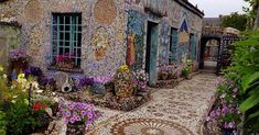 How Raymond Isidore Transformed His Small Home into Mosaic Art