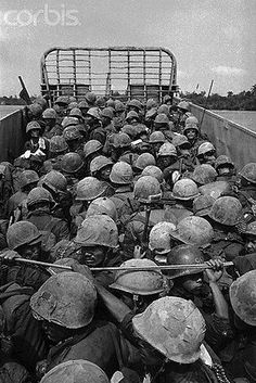 15 Feb 1968, Hue, South Vietnam --- South Vietnamese Marines cross the Perfume River in a landing craft for the final assault on the ancient imperial capital of Hue. south Vietnamese troops blasted through a gate of the Imperial Palace on February 24th and won the 25-day battle for Hue. Grimy U.S. Marines held back and watched as the government forces stormed the palace against light resistance. --- Image by © Bettmann/CORBIS