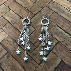 A personal favorite from my Etsy shop https://www.etsy.com/listing/544810059/silver-drop-stars-on-chains-earrings
