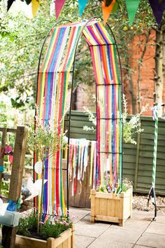 Ribbon Ceremony Arch Photo by Anushe Low via Style Me Pretty