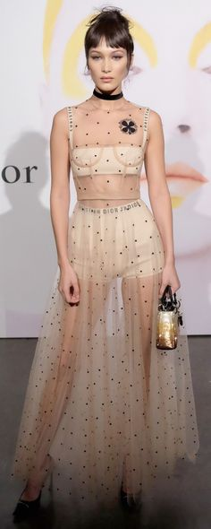 Who made  Bella Hadid's sequin handbag and mesh polka dot gown?