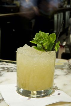 """Eastern Standard, Boston   Whiskey may be your go-to cold-weather liquor, but this hip Boston bar's Whiskey Smash transcends seasonality, with summer flavors lemon and mint making it a refreshing escape from the city's heat and humidity. 2 oz William Weller Special Reserve bourbon 1 oz simple syrup 5 mint leaves 1/2 lemon, cut into quarters Mint sprig, for garnish Muddle mint, lemon, and syrup in a mixing glass. Add the bourbon and """"dry shake' (a process of capping the glass with a Boston…"""