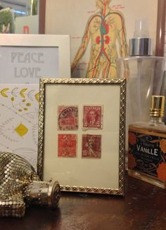 Four framed antique stamps - Pink and red antique postage stamps in a gold colored antique frame. French stamp, Canadian stamp, 1931 stamp. $12.00, via Etsy.