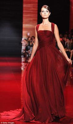 Ladies in red: Saab loves a rich crimson and used it to make a number of gowns, including this elegant sequinned frock (left) and a draped number (right)