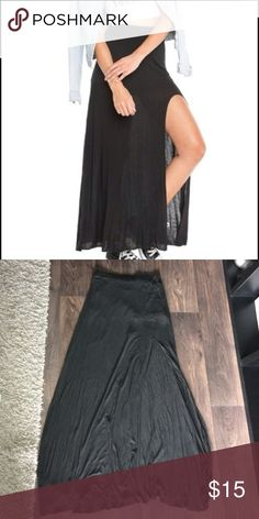 Brandy Melville high slit maxi never worn because it's way too long on me. It's a very sexy skirt with the high slit and can be dressed up or down. Really wish it was shorter for me! Excellent condition Brandy Melville Skirts Maxi