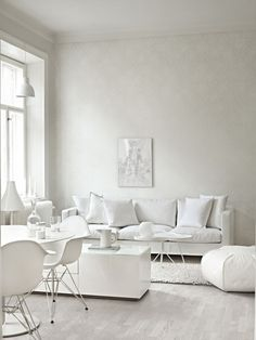 This all-white living room looks comfy as can be.
