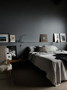 Cozy and stylish bedroom with grey walls in photographer Pia Ulin's loft