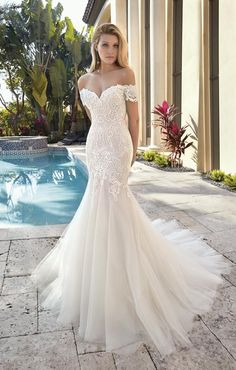 unique wedding dress Off-the-shoulder Cap sleeves add a romantic touch to this alluring Sweetheart neck Fit n flare design adorned with bold embroidered lace. A lush Tulle, flared skirt flows into a Chapel train. Light Blue Wedding Dress, Classy Wedding Dress, Fit And Flare Wedding Dress, Wedding Dress Sleeves, Dress Wedding, Lace Wedding, Elegant Wedding, Glamorous Wedding, Flare Dress
