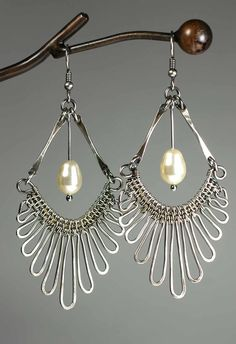 Gypsy Earrings with Kaska Firor. Use wire-weaving, wire-wrapping and simple forging techniques to complete the earrings. Techniques: Metalwork, Wire Work.