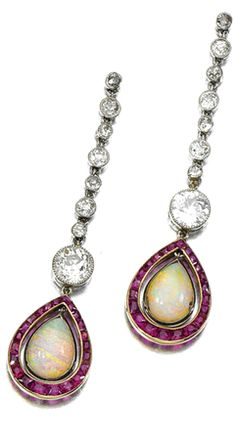 OPAL, RUBY AND DIAMOND EAR PENDANTS AND , EARLY 20TH CENTURY  Each earring suspending a pear-shaped opal swing set within a border of calibré-cut rubies, to a line millegrain-set with circular- and single-cut diamonds, later post and butterfly fittings, case WM Bruford & Son Ltd;