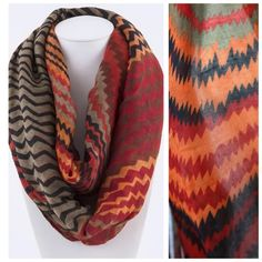 """B35 Chevron Red Brown Orange Black Infinity Scarf Big full infinity scarf.  Absolutely gorgeous.  Shades of orange, red, black, rust & brown.  Multi pattern.  Please check my closet for many more items!!  Length 40""""  Width 35"""" Boutique Accessories Scarves & Wraps"""