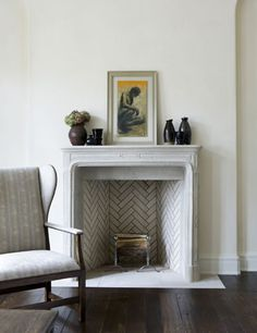 """Lausanne"" stone fireplace mantel from Francois & CO, room design by James Michael Howard"