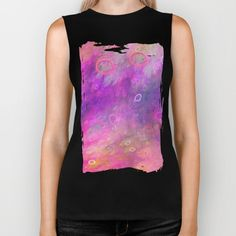 Soft colourful dreamy abstract design with floating rings and artistic effects. The colors are pink, purple, green, yellow...