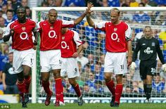 Arsenal team-mates Thierry Henry and Dennis Bergkamp celebrate a goal against Everton in 2004. And that's Lauren to the left...