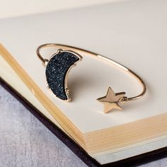 Beautiful and sparkly druzy stone moon and star cuff bracelet Perfect for stacking or by itself.Druzy stone in available in black, silver, grey and gold. There is beautfiul gift wrapping available with every purchase if required for only £1.50! Please see our picture and choose your option! Watches are sent in the long rectangular boxes and bracelets in the square (Subject to stock levels).Our accessories are designed to fit in with everyday life, meaning you can wear them anywhere. Th...