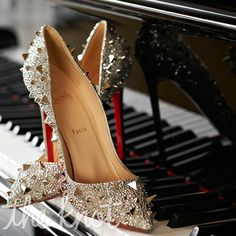 I'm in love with this unique and unexpected look of silver spike Louboutin stilettos for the wedding day...and beyond!