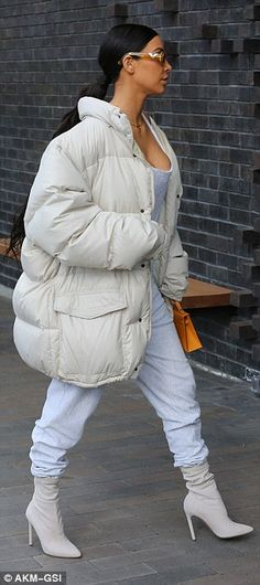 Feeling cold? She tucked the sweats into heeled ankle boots and added a puffy jacket that covered her famously ample derriere as she headed into a restaurant
