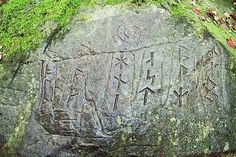 Rune carving is from the Externsteine in Germany.
