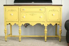 mustard yellow sideboard with natural wood finish top