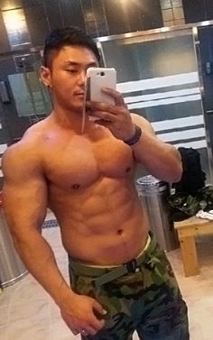 Shirtless Asian hunk does a mirror selfie