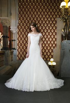 Brides.com: . Style 8708, off-the-shoulder Alencon lace and tulle mermaid wedding dress, Justin Alexander